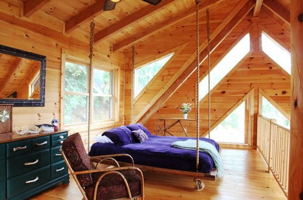 wood-attic-room-multiple-windows-hanging-bed