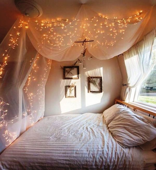 bed-placed-near-window-canopy
