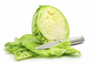 cut of green cabbage vegetable isolated on white background